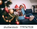 mother and daughter unpacking a ... | Shutterstock . vector #779767528