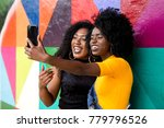afro women decent taking selfie ... | Shutterstock . vector #779796526