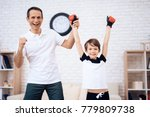 father and son posing on the... | Shutterstock . vector #779809738