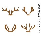 set of brown reindeer antlers... | Shutterstock .eps vector #779843140