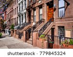 a row of brownstone buildings | Shutterstock . vector #779845324