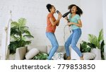 mixed race young funny girls... | Shutterstock . vector #779853850