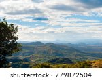 panoramic view of mountains and ... | Shutterstock . vector #779872504