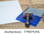 Rubber Stamp With The Blue Ink...