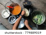 hand of a man serving meal on... | Shutterstock . vector #779889019