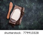 fresh butter and knife on... | Shutterstock . vector #779913328