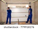 contractors installing  repair  ... | Shutterstock . vector #779918176