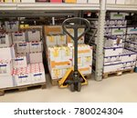 lifting cart with goods in a... | Shutterstock . vector #780024304
