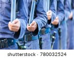 Small photo of Air cadet trained by long gun to practice about tolerance and strength before marching training with gun.