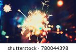 abstract sparklers with... | Shutterstock . vector #780044398