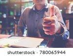 smart businessman at workplace... | Shutterstock . vector #780065944