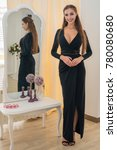 Small photo of Beautiful showy girl in a frank evening dress
