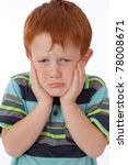 Young red head boy holding face and looking sad and despondant - stock photo