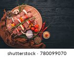 raw kebab from meat on a wooden ... | Shutterstock . vector #780099070