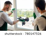 young guys installing a window. ... | Shutterstock . vector #780147526