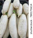 Small photo of Daikon, also known by many other names depending on context, is a mild-flavored winter radish usually characterized by fast-growing leaves and a long, white, napiform root.