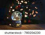 christmas snowglobe on bokeh...   Shutterstock . vector #780206230