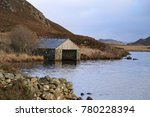 Small photo of Winter light to the boat house on Cregennan Lake on the northern slopes of Cadair Idris near Dolgellau, Wales, UK.