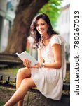 young woman reading a book   Shutterstock . vector #780267013