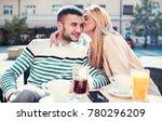 flirting in a cafe. beautiful... | Shutterstock . vector #780296209
