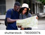 happy couple of tourists  man... | Shutterstock . vector #780300076