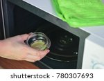 hand with microfiber cleaning... | Shutterstock . vector #780307693
