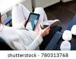young woman sitting by the...   Shutterstock . vector #780313768