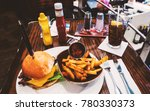 tasty burger in a restaurant in ... | Shutterstock . vector #780330373