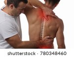 Small photo of Man having chiropractic back adjustment. Osteopathy, Physiotherapy, sport injury rehabilitation concept
