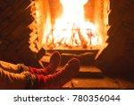 warming christmas eve fireplace ... | Shutterstock . vector #780356044