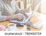 close up of woman hands using...   Shutterstock . vector #780400729