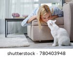 quite girl lying on daybed and... | Shutterstock . vector #780403948