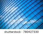 clouds reflected in windows of... | Shutterstock . vector #780427330