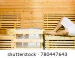 close up man leg on wooden seat ... | Shutterstock . vector #780447643