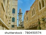 Small photo of Minaret of the Mosque of Omar next to the courtyard of the Church of the Holy Sepulchre in the old city of Jerusalem, Israel.