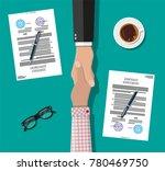 two businessman shake hands...   Shutterstock . vector #780469750