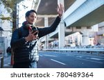 young man holding cellphone... | Shutterstock . vector #780489364