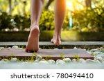 barefoot girl walking on the... | Shutterstock . vector #780494410