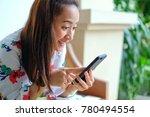 girl happy reading message on...   Shutterstock . vector #780494554