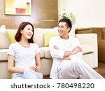 asian couple sitting relaxing... | Shutterstock . vector #780498220