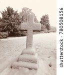 Stone Cross In A Cemetery...