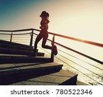 sporty female runner running... | Shutterstock . vector #780522346