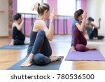 women practicing yoga together... | Shutterstock . vector #780536500