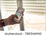 smart home  man controlling... | Shutterstock . vector #780546940