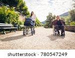 young parents in wheelchair... | Shutterstock . vector #780547249