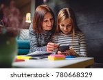 mother and daughter doing...   Shutterstock . vector #780668329