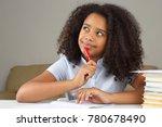 black schoolgirl is thinking... | Shutterstock . vector #780678490