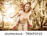 mother and daughter outdoors in ... | Shutterstock . vector #780692410