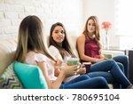 cute female friends enjoying a... | Shutterstock . vector #780695104