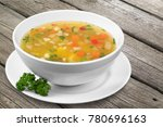 vegetable soup on table | Shutterstock . vector #780696163
